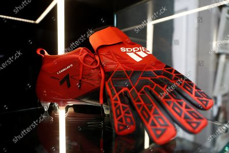 A soccer boot and glove signed by Spanish goalkeeper Iker Casillas is presented prior to be be auctioned at the 'I art and sport international solidarity auction'  at the Ansorena auction house in Madrid, Spain, 19 October 2020. The collected benefits of the 'I art and sport international solidarity auction' will be used by the Real Madrid fundation in Centers for Minors and for people with disabilities.