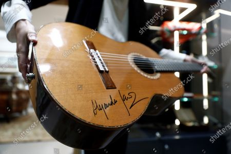 Stock Image of A signed guitar of Spanish guitaris and composer Alejandro Sanz is presented prior to be be auctioned at the 'I art and sport international solidarity auction'  at the Ansorena auction house in Madrid, Spain, 19 October 2020. The collected benefits of the 'I art and sport international solidarity auction' will be used by the Real Madrid fundation in Centers for Minors and for people with disabilities.