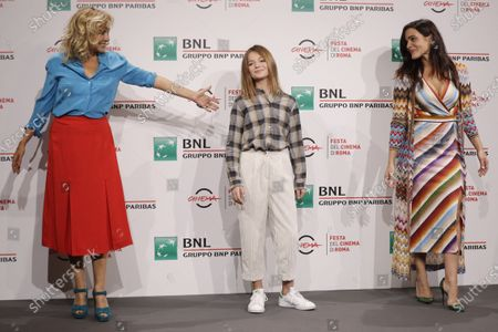 """From left actresses Valeria Golino, Pina Turco and Cristina Magnotti pose for photographers during the photo call for the movie """"Fortuna"""" at the Rome Film Festival, in Rome"""