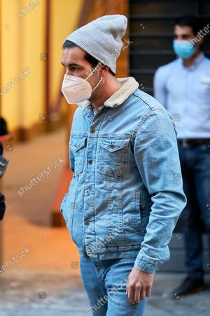 """Mario Casas wearing a face mask seen coming out of Proyecciones Cinema after the screening of the movie """"No Mataras"""" (Cross the Line)"""