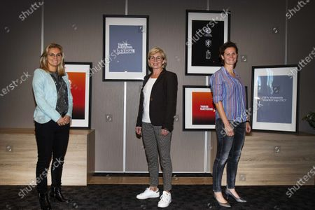 Stock Picture of (L-R) Dutch national women soccer team head coach Sarina Wiegman, former German player Silvia Neid, and former Belgian player Femke Maes pose for photographers in Eindhoven, Netherlands, 06 October 2020 (issued on 19 October 2020). The three countries of the Netherlands, Germany, and Belgium have announced a joint bid to host the FIFA Women's World Cup in 2027, their football associations confirmed on 19 October 2020.
