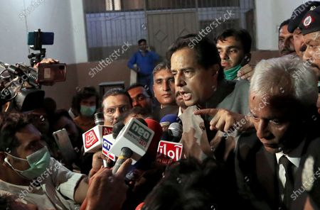 Mohammad Safdar, son-in-law of former Pakistani Prime Minister Nawaz Sharif, gestures as he speaks to journalists after a court granted him bail, outside a court in Karachi, Pakistan, . Pakistani police briefly detained Safdar, on Monday, accusing him of leading a crowd in a chant against the military at the tomb of the country's founder