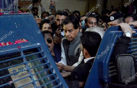 Mohammad Safdar, center, son-in-law of former Pakistani Prime Minister Nawaz Sharif, leaves after a court granted him bail, in Karachi, Pakistan, . Pakistani police briefly detained Safdar on Monday, accusing him of leading a crowd in a chant against the military at the tomb of the country's founder