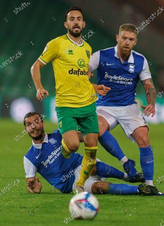 Ivan Sunjic of Birmingham City (34) tackles Lukas Rupp of Norwich City (7) and Adam Clayton of Birmingham City (8) looks on