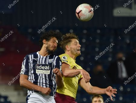 Ahmed Hegazi (L) of West Bromwich in action against James Tarkowski (R) of Burnley during the English Premier League soccer match between West Bromwich Albion and Burnley FC in West Bromwich, Britain, 19 October 2020.