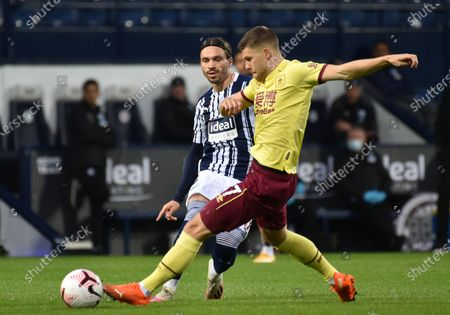 Filip Krovinovic (L) of West Bromwich in action against Johann Berg Gudmundsson (R) of Burnley during the English Premier League soccer match between West Bromwich Albion and Burnley FC in West Bromwich, Britain, 19 October 2020.