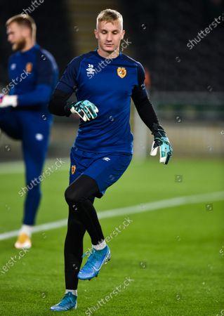 Goalkeeper David Robinson of Hull City warms up