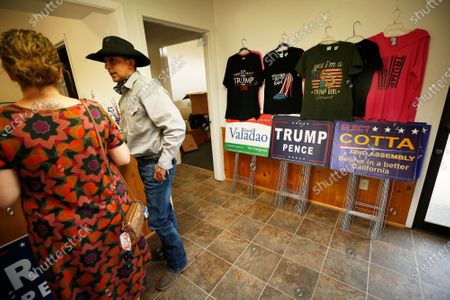 Daniel and Melanie Bocanegra from Hanford shop for items at the the Kings County Republican headquarters in Hanford, CA which is filled with Trump/Pence and David Valadao gear and large signs. This is home to a very close Congressional race in District 21 in the San Joaquin Valley. The position was held by four-time Republican David Valadao, who lost by fewer than 1,000 votes in 2018 to Democrat TJ Cox in a major surprise and they are facing off again. It is a mostly Democratic, rural, agricultural district that is 75% Latino, but Valadao is a local who had a lot of support. Congressional District 21 San Joaquin Valley on Monday, Oct. 12, 2020 in Hanford, CA. (Al Seib / Los Angeles Times