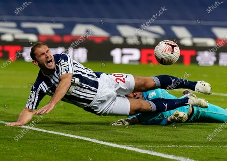 West Brom's Branislav Ivanovic reacts as he collides with Burnley's goalkeeper Nick Pope during the English Premier League soccer match between West Bromwich Albion and Burnley at the Hawthorns in West Bromwich, England