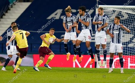 Stock Photo of Burnley's Johann Berg Gudmundsson takes a free kick during the English Premier League soccer match between West Bromwich Albion and Burnley at the Hawthorns in West Bromwich, England