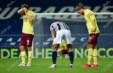 West Brom's Jake Livermore, centre, Burnley's Chris Wood, left, and Jay Rodriguez, right, react following the English Premier League soccer match between West Bromwich Albion and Burnley at the Hawthorns in West Bromwich, England