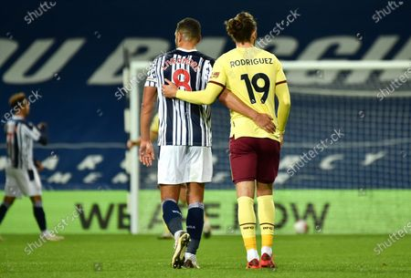 West Brom's Jake Livermore, left, and Burnley's Jay Rodriguez embrace following the English Premier League soccer match between West Bromwich Albion and Burnley at the Hawthorns in West Bromwich, England