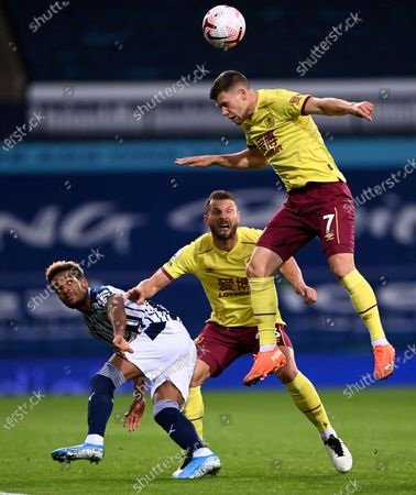 Burnley's Johann Berg Gudmundsson leaps to head the ball during the English Premier League soccer match between West Bromwich Albion and Burnley at the Hawthorns in West Bromwich, England