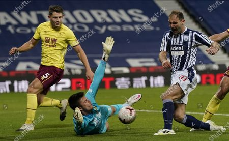 Branislav Ivanovic (R) of West Bromwich in action against Burnley's goalkeeper Nick Pope (C) during the English Premier League soccer match between West Bromwich Albion and Burnley FC in West Bromwich, Britain, 19 October 2020.