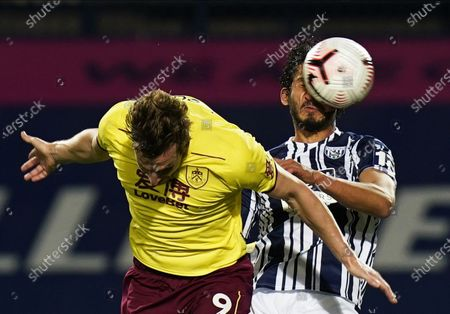Ahmed Hegazi (R) of West Bromwich in action against Chris Wood (L) of Burnley during the English Premier League soccer match between West Bromwich Albion and Burnley FC in West Bromwich, Britain, 19 October 2020.