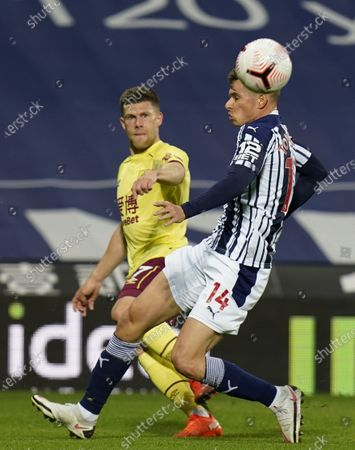 Conor Townsend (R) of West Bromwich in action against Johann Berg Gudmundsson (L) of Burnley during the English Premier League soccer match between West Bromwich Albion and Burnley FC in West Bromwich, Britain, 19 October 2020.