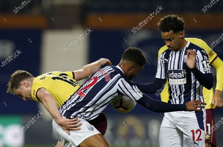 Jay Rodriguez (L) of Burnley in action against West Bromwich players Darnell Furlong (C) and Matheus Pereira (R) during the English Premier League soccer match between West Bromwich Albion and Burnley FC in West Bromwich, Britain, 19 October 2020.