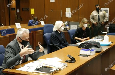 Los Angeles County Deputy District Attorney Reinhold Mueller, left, addresses the judge at a hearing for actor Danny Masterson, who is facing multiple rape charges, at the Clara Shortridge Foltz Criminal Justice Center in Los Angeles. Looking on are Masterson's attorneys Thomas Mesereau, center, and Sharon Appelbaum