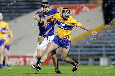 Stock Photo of Clare vs Tipperary. Clare's Gearoid Cahill and Kian O'Kelly of Tipperary