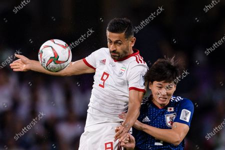 Omid Ebrahimi Zarandini of Iran (L) fights for the ball with AAA during the Semi Finals match