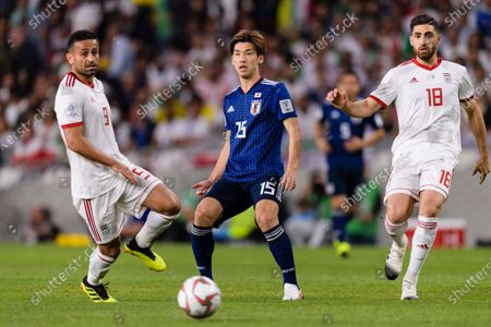 Osako Yuya of Japan (C) fights for the ball with Omid Ebrahimi Zarandini of Iran (L) and Alireza Jahan Bakhsh Jirandeh of Iran (R) during the Semi Finals match