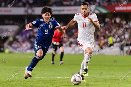 Stock Photo of Morteza Pouraliganji of Iran (R) fights for the ball with Minamino Takumi of Japan (L) during the Semi Finals match