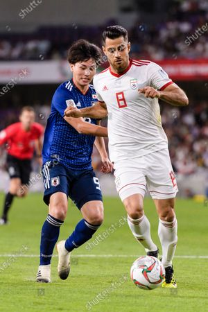 Stock Picture of Morteza Pouraliganji of Iran (R) fights for the ball with Minamino Takumi of Japan (L) during the Semi Finals match