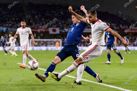 Morteza Pouraliganji of Iran (R) fights for the ball with Minamino Takumi of Japan (C) during the Semi Finals match