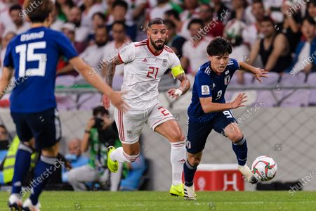 Minamino Takumi of Japan (R) fights for the ball with Seyed Ashkan Dejagah of Iran (C) during the Semi Finals match