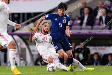 Minamino Takumi of Japan (R) fights for the ball with Seyed Ashkan Dejagah of Iran (L) during the Semi Finals match