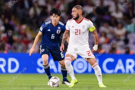 Seyed Ashkan Dejagah of Iran (R) fights for the ball with Endo Wataru of Japan (L) during the Semi Finals match