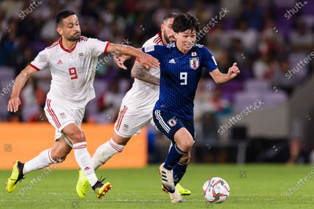 Minamino Takumi of Japan (C) fights for the ball with Omid Ebrahimi Zarandini of Iran (L) during the Semi Finals match
