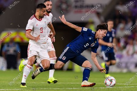 Minamino Takumi of Japan (R) fights for the ball with Omid Ebrahimi Zarandini of Iran (L) during the Semi Finals match