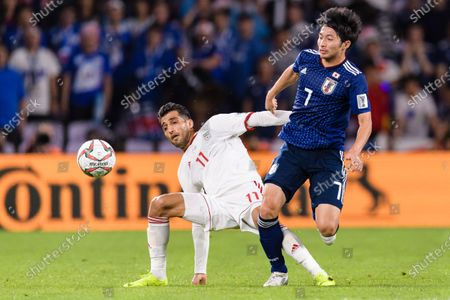 Shibasaki Gaku of Japan (R) fights for the ball with Vahid Amiri of Iran (L) during the Semi Finals match
