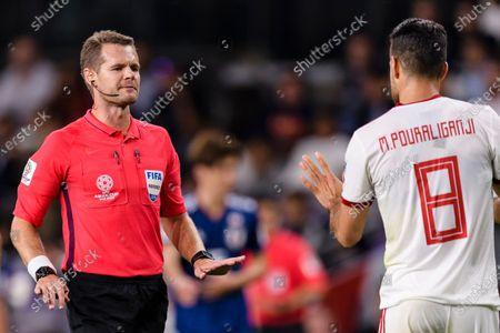Stock Image of FIFA Referee Christopher Beath of Australia (L) talks to Morteza Pouraliganji of Iran (R) during the Semi Finals match