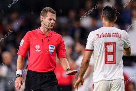 FIFA Referee Christopher Beath of Australia (L) talks to Morteza Pouraliganji of Iran (R) during the Semi Finals match