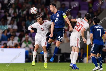 Vahid Amiri of Iran (L) fights for the ball with Yoshida Maya of Japan (C) during the Semi Finals match