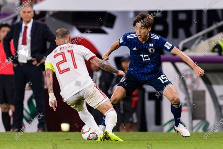 Osako Yuya of Japan (R) fights for the ball with Seyed Ashkan Dejagah of Iran (L) during the Semi Finals match
