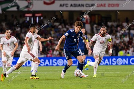 Stock Image of Osako Yuya of Japan (C) fights for the ball with Seyed Ashkan Dejagah of Iran (R) during the Semi Finals match