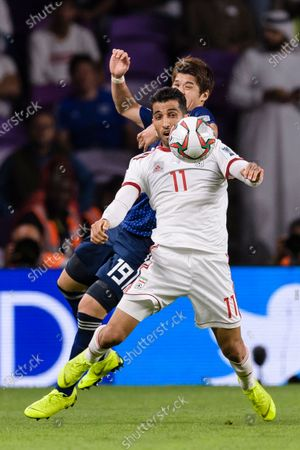 Vahid Amiri of Iran (front) fights for the ball with Sakai Hiroki of Japan (back) during the Semi Finals match