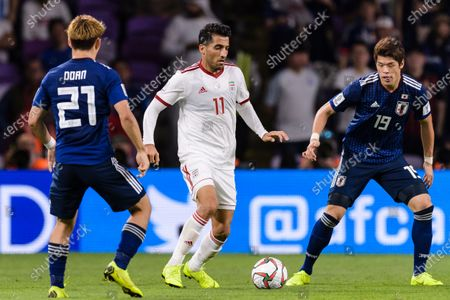 Vahid Amiri of Iran (C) fights for the ball with Sakai Hiroki of Japan (R) and Doan Ritsu of Japan (L) during the Semi Finals match