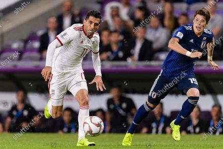 Vahid Amiri of Iran (L) fights for the ball with Sakai Hiroki of Japan (R) during the Semi Finals match