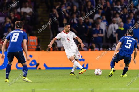 Omid Ebrahimi Zarandini of Iran (C) in action during the Semi Finals match