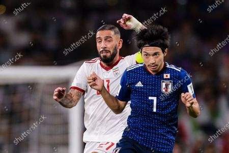 Shibasaki Gaku of Japan (R) fights for the ball with Seyed Ashkan Dejagah of Iran (L) during the Semi Finals match