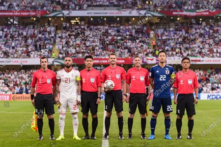 Stock Picture of Yoshida Maya of Japan (R2) and Seyed Ashkan Dejagah of Iran (L2) pose for photos among referees prior the Semi Finals match