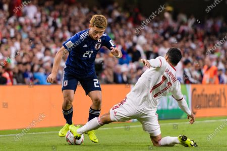 Doan Ritsu of Japan (L) fights for the ball with Vahid Amiri of Iran (R) during the Semi Finals match