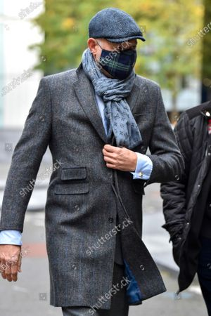 Stock Picture of John L Stott better known as John Leslie wearing a face mask leaves Southwark Crown Court in London today after being found not guilty of groping a women's breasts at a party in 2008