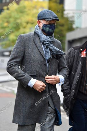 Stock Image of John L Stott better known as John Leslie wearing a face mask leaves Southwark Crown Court in London today after being found not guilty of groping a women's breasts at a party in 2008
