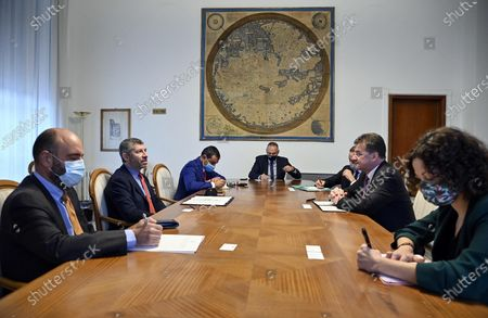 Ivan Scalfarotto (2-L), Member of the Italian Chamber of Deputies, attends a meeting with Miroslav Lajcak (2-R), the EU Special Representative for the Belgrade-Pristina Dialogue and other Western Balkan regional issues, at the Ministry of Foreign Affairs in Rome, Italy, 19 October 2020. Others are not identified.