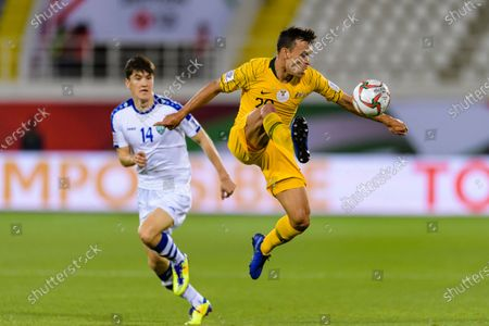 Trent Sainsbury of Australia (R) in action during the Round of 16 match